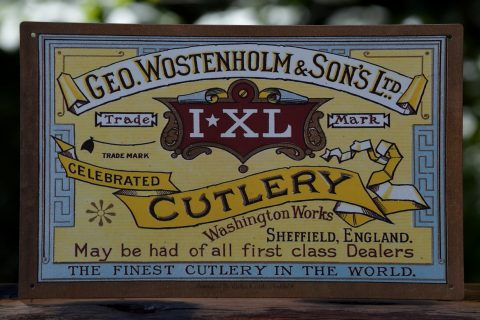 George Wostenholm & Son's Tin Sign